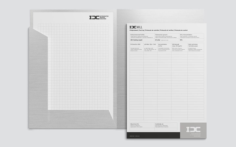 IDC Mappe mit Notizzettel und Formular
